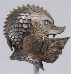 A Milanese burgonet, bearing the visage of a terrifying dragon, 17th century. (Musee de l'Armee)