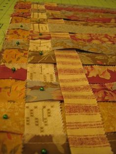 DIY woven rug. Fold strips in half and stitch then weave as is. Home decor fabric. Heavier weight Repurposed clothing would wirk