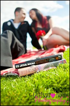 Carissa Holm Photography. Harry Potter Vs. Star Wars wedding ring photo. Engagement Photography. Couple Photography.