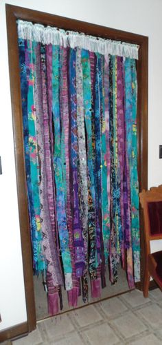 Handmade one of a kind door curtain that is as much fun to walk through as it is to look at!!! Each strip of fabric hands loose so it can easily be walked through OR pin it back on each side for window curtain OR hang on the wall behind your bed! This is two separate panels so it can easily be opene...