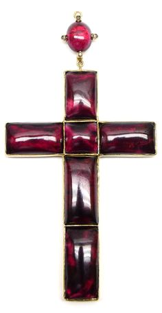 Antique carbuncle garnet cross pendant, formed by five rectangular and one square cabochon garnet, close set in gold, with an oval cabchon garnet and rose diamond loop 4cm wide, 6cm long excluding loop