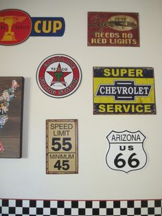 Boys Cars Route 66 Room, This room was inspired by my sons love of Disney Cars and the great Lightning McQueen. I mixed his desires with a vintage Route 66 garage feel. , Tin signs.   , Boys Rooms Design