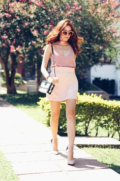 Wearing my favourite colour in an all baby pink outfit. Mini skirt and top with high heels, chocker, mini bag and sunglasses.