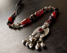 Long Pirate Hair Jewels in Black and Red by Faire Treasures, $30.00