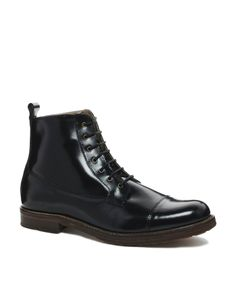 Boots with laces. Looks best with jeans. Also with level 2 casual tailored clothes I.e. pants with shirts.