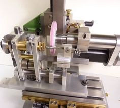 Cam-Grinder: A high precision cam grinding machine for small parts