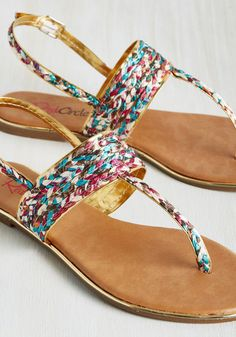 An adventure to the ancient art exhibition wouldn't be complete without these T-strap sandals! Turning an educational excursion into a thrilling trek with their vibrant braided motif and shiny gold accents, these vegan faux-leather kicks deserve an action-packed display of their own.