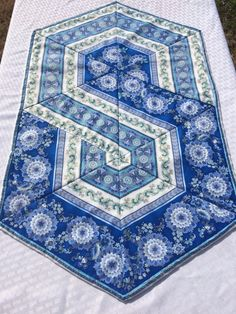 Triangle Frenzy Swirl Hexagon Table Runner Centerpiece Table Topper by Heathersquaintquilts on Etsy https://www.etsy.com/listing/217600278/triangle-frenzy-swirl-hexagon-table