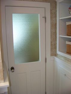 Install a frosted window in the door of the windowless bathroom.