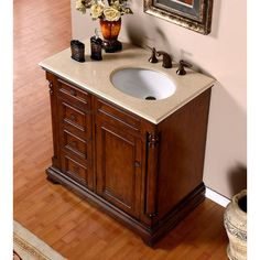 furniture astonishing bathroom vanity with sink on right side using oval undermount basin for cream granite countertops and oil rubbed bronze single hole faucet above dark cherry cabinets