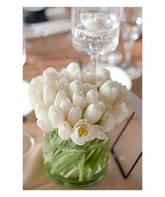 Centerpieces  Wedding table with vase of white tulips - small, simple, affordable but effective?