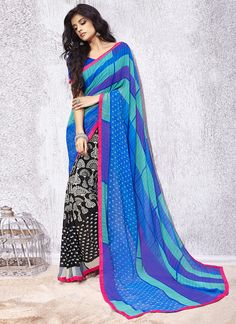Unique elegance can come out through the dressing design with this multi colour georgette casual saree. You could see some interesting patterns completed with print work. Comes with matching blouse. (...