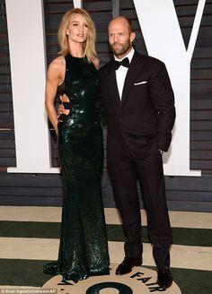Making an entrance: Rosie Huntington-Whiteleymade a stunning entrance at the Vanity Fair Oscar Party with Hollywood boyfriend Jason Statham, on Sunday
