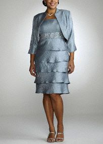 Sophisticated and chic, this two-piece shimmer jacket dress is the perfect go-to for any special occasion.  Tank bodice features elegantly beaded and embroidered waist for added glamour.  Tiered skirt is fashion-forward and flattering.  Optional jacket offers chic coverage without compromising style.  Shimmer fabric is comfortable and radiant.  Fully lined. Back zip. imported polyester blend. Dry clean only.  Available in Platinum. To protect your dress, our Non Woven Garment Bag is a must…