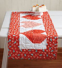 Easy-to-make table topper using pre-cuts! Made by Jenny Doan!