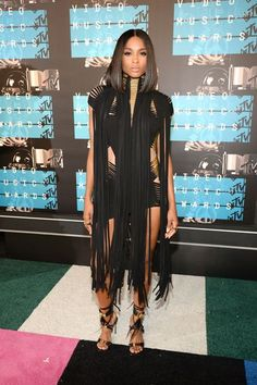CiaraWe're actually getting used to seeing fringed-up looks like these on the red carpet, but Ciara plays with proportions in this mini Alexandre Vauthier with extra-long fringe overlay. Black may not be the most daring shade for a statement-making night like the VMAs, so Ciara took it up a notch with a peek-a-boo, car-wash effect and equally strappy heels. #refinery29 http://www.refinery29.com/2015/08/93120/video-music-awards-best-dressed-red-carpet-pictures-2015#slide-9