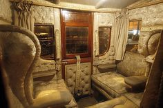 The interior of the state carriage of Carlow. Princess Morgen sat in the wing chair on the left. The windows are much larger. See the exterior photo of the state carriage for an example.