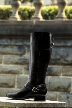 This Lauren Ralph Lauren Leather Riding Boot is a timeless, equestrian-inspired classic. Crafted from smooth burnished calfskin and designed with a  gleaming, gold-toned stirrup-shaped buckle