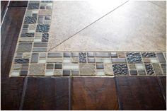 5f5ff47ad5 CLOSE-UP  Love this custom tile inset on the dark hardwood floors in the