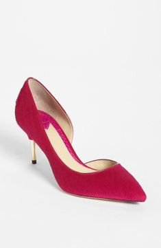 Pink pump, gold heel.