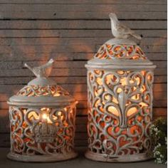 candle lit ceramic bird jars I would love these for my living room!