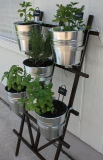 DIY hanging herb garden using trellis from Home Depot and hanging planter pots from Ikea. Great way to grow herbs for a rental or apartment patio, as they are not in the ground. More on www.fabeveryday.com