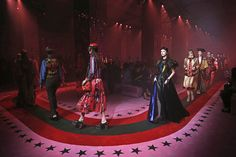 Milan Fashion Week kicks off with cat debutante ball gowns, two-in-one platforms, giant hats and tinsel capes at Gucci.