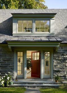 too much glass  by Krieger + Associates Architects Inc  A new dormer window and front door with sidelites help brighten the interior of this renovated carriage house.