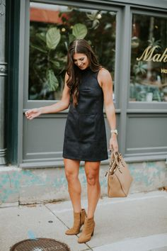 Black suede shift dress + brown booties + tan purse