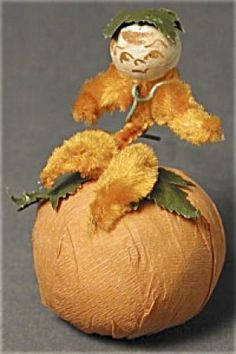 Lot: 373462: Vintage Pumpkin Vine Boy Candy Container, Lot Number: 373462, Starting Bid: $185, Auctioneer: TIAS, Inc., Auction: Vintage Halloween and Other Oddities, Date: September 21st, 2006 CDT