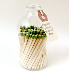 This repurposed apothecary matchstick bottle serves as a display-worthy alternative to any matchbox. The bottom of each jar is etched to create a strikeable surface