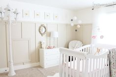 simple, white baby room