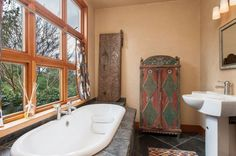 Antique Door Panel & Javanese Cabinet from Indonesia. Bathroom in main house on Vashon Island. Photo: Courtesy Beth De Groen/Windermere Real Estate