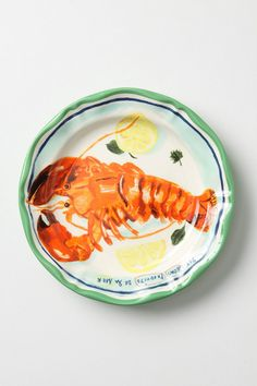 """Like crustacean fresh off the Martinique coast, this mouthwatering dish looks good enough to eat. An Anthropologie exclusive from Parisian artist Nathalie Lete.  Stoneware  Dishwasher and microwave safe  10.25"""" diameter"""