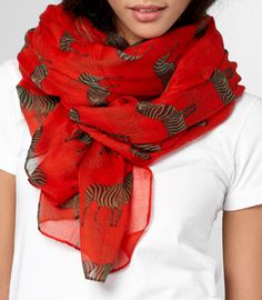 This scarf reminds me that I love zebras. Now i love scarfs with zebras on them.