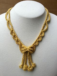Looking glass necklace.  Free pattern on ravelry.  Very cute bow with dangles and bobbles! ✿⊱╮Teresa Restegui http://www.pinterest.com/teretegui/✿⊱╮