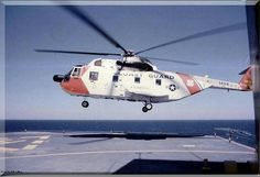 HH-3F Sykorsky landing at sea somewhere.
