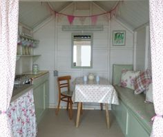 Beach hut beautifully decorated in a vintage country style.