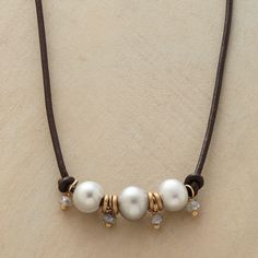"Sundance $298. PEARL LINEUP NECKLACE�--�Cultured gray pearls, mystic labradorites and 10kt gold disks line up between brown leather knots. Hook clasp. A Sundance exclusive by Rebecca Lankford, handmade in USA. 16"" to 17""L."