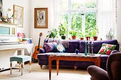 Beautiful Eclectic / Bohemian Style Room Décor. Love the natural light, plants, sofa, piano.