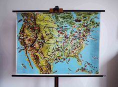 Vintage Economic Map of North America - School Wall Pull Down Chart - Economy, Geography, Cartography, History, USA Canada Travel  Here we are offering a vintage school pull-down wall economic map depicting the prominent regional industries of North America. Made in Germany from Georg Westermann (Braunschweig, Germany) and dates approximately to the 1960s. Printed on paper with a linen backing and mounted on wood supports. It is a beautifully illustrated map in a very vivid range of colors…