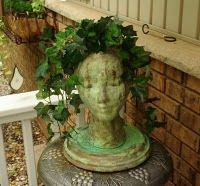Upcycle-Styrofoam wig head to garden statue planter. I made this and am so pleased. Used a few different colors but basically the same. I did put live creeping jenny and a small ground cover in the opening and set it out by our pond. Would do another!