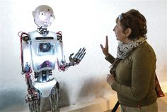 Image: A woman greets the British humanoid robot Thespian during the Robot Ball exhibition in Moscow on May 15 (© Sergei Savostyanov/ITAR-TA...
