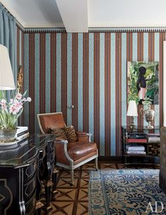 Michael Smith's NYC residence. The walls of the guest room are lined with a striped fabric and decorative border, both by Edmond Petit from Stark Carpet.
