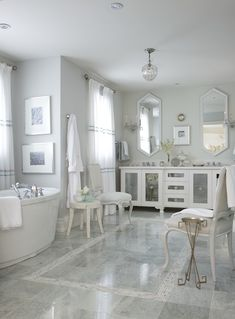 Glamorous master bathroom with gray walls paint color, white mirrored double bathroom vanity with white quartz countertop, freestanding tub, marble tiles floor with mosaic marble inset tiles