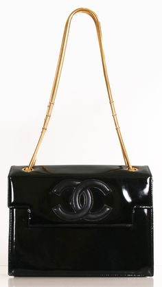 "Chanel Black Patent Leather Vintage Hand-Bag with Gold Hardware Straps. A signature vintage Chanel with the iconic Chanel logo on the clasp. Beautiful structured and symmetrical. Versatile for any evening occasion. Gold coiled chains had a bold accent to the bag. 10"" x 8"" x 20"""