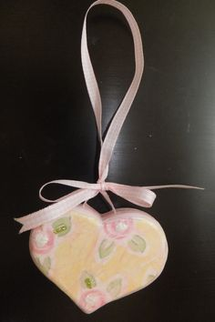 A heart that I made to hang form one of my shelf's. I love country garden/shabby chic style.