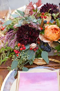Table arrangements -  Plum and Gold Wedding Inspiration