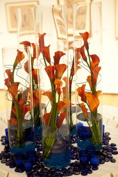 Orange Calla Lilly w/ wires, modern table arrangement, blue accents