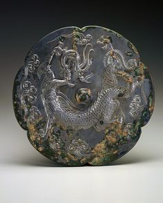 Lobed mirror with a dragon and clouds, first half of the century. Chinese China, Chinese Art, Chinese Style, Dragon Dreaming, Year Of The Dragon, Bronze Mirror, Dragon Jewelry, Historical Art, Chinese Ceramics